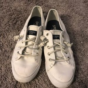 All white Sperry shoes